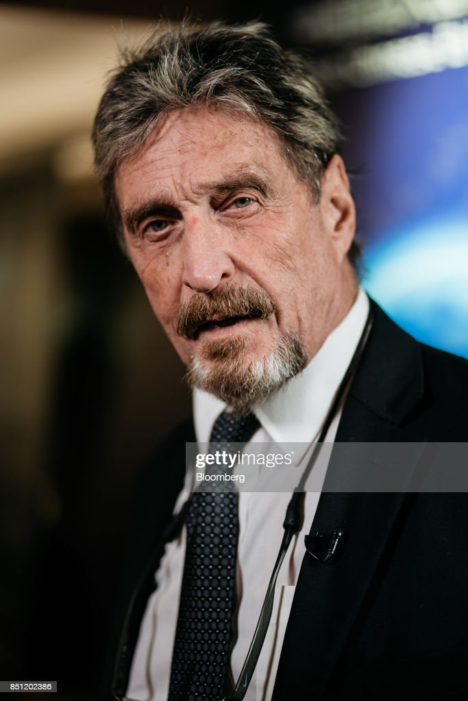John McAfee, founder of McAfee Associates Inc. and chief cybersecurity visionary at MGTCapital Investments Inc., speaks during a Bloomberg Television interview on the sidelines of the Shape the Future: Blockchain Global Summit in Hong Kong, China, on Wednesday, Sept. 20, 2017. McAfee, who now runs a bitcoin mining company, says China's banning of initial coin offerings won't halt the momentum of cryptocurrencies globally. Photographer: Anthony Kwan/Bloomberg via Getty Images