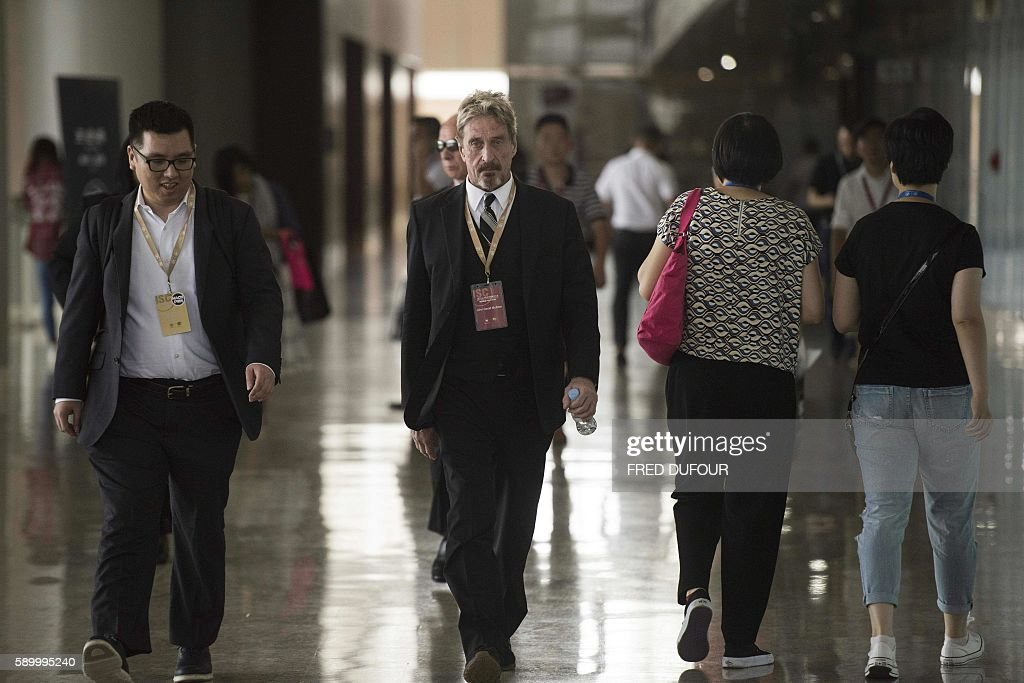 John McAfee founder of the eponymous antivirus company arrives at the China Internet Security Conference in Beijing on August 16 2016 / AFP / FRED...