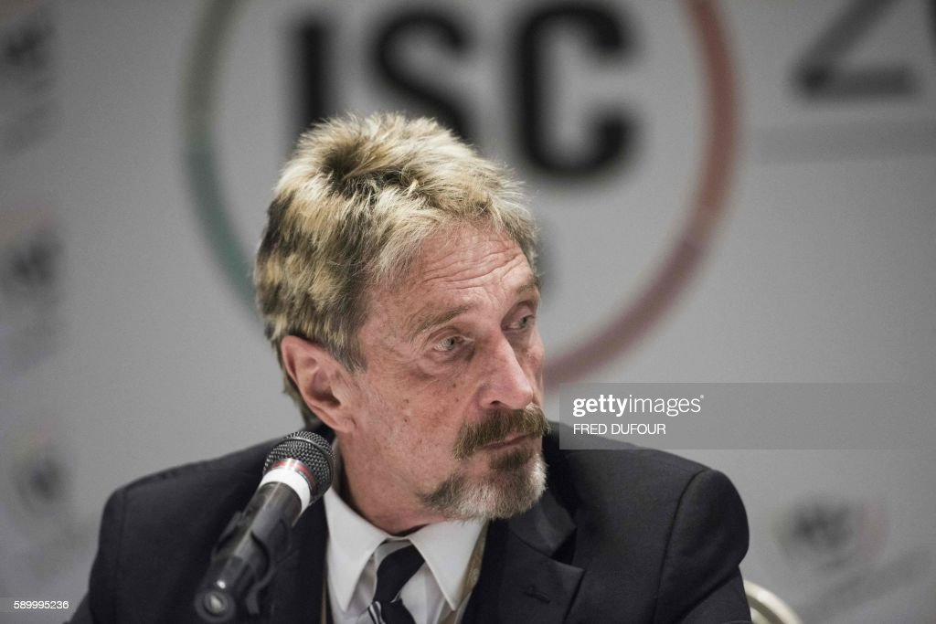 John McAfee founder of the eponymous antivirus company speaks to journalists at the China Internet Security Conference in Beijing on August 16 2016 /...