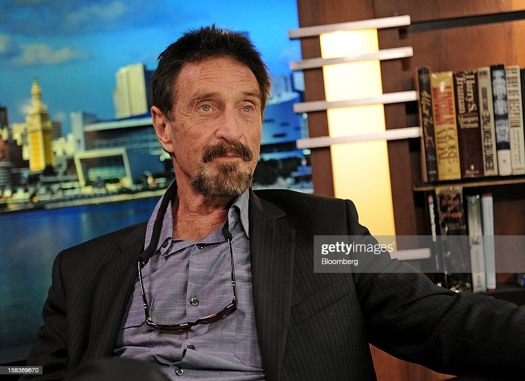 <a gi-track='captionPersonalityLinkClicked' href=/galleries/search?phrase=John+McAfee&family=editorial&specificpeople=1353446 ng-click='$event.stopPropagation()'>John McAfee</a> pauses during an interview in Miami, Florida, U.S., on Friday, Dec. 14, 2012. McAfee, who is wanted for questioning in the shooting of an American citizen in Belize, was denied asylum by Guatemala. Photographer: Louis Lanzano/Bloomberg via Getty Images