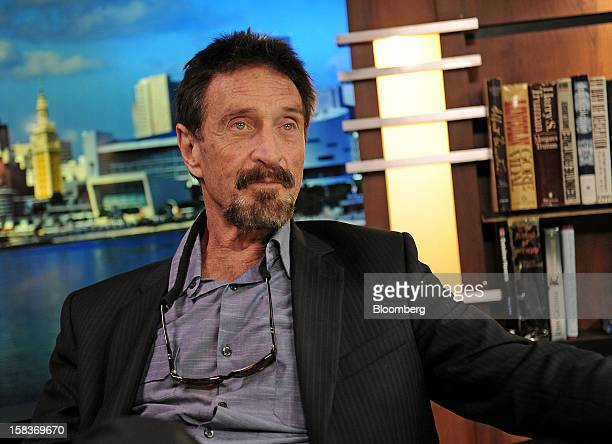 John McAfee pauses during an interview in Miami Florida US on Friday Dec 14 2012 McAfee who is wanted for questioning in the shooting of an American...