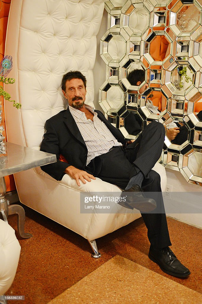 <a gi-track='captionPersonalityLinkClicked' href=/galleries/search?phrase=John+McAfee&family=editorial&specificpeople=1353446 ng-click='$event.stopPropagation()'>John McAfee</a> poses for a portrait at his hotel in South Beach on December 13, 2012 in Miami Beach, Florida.