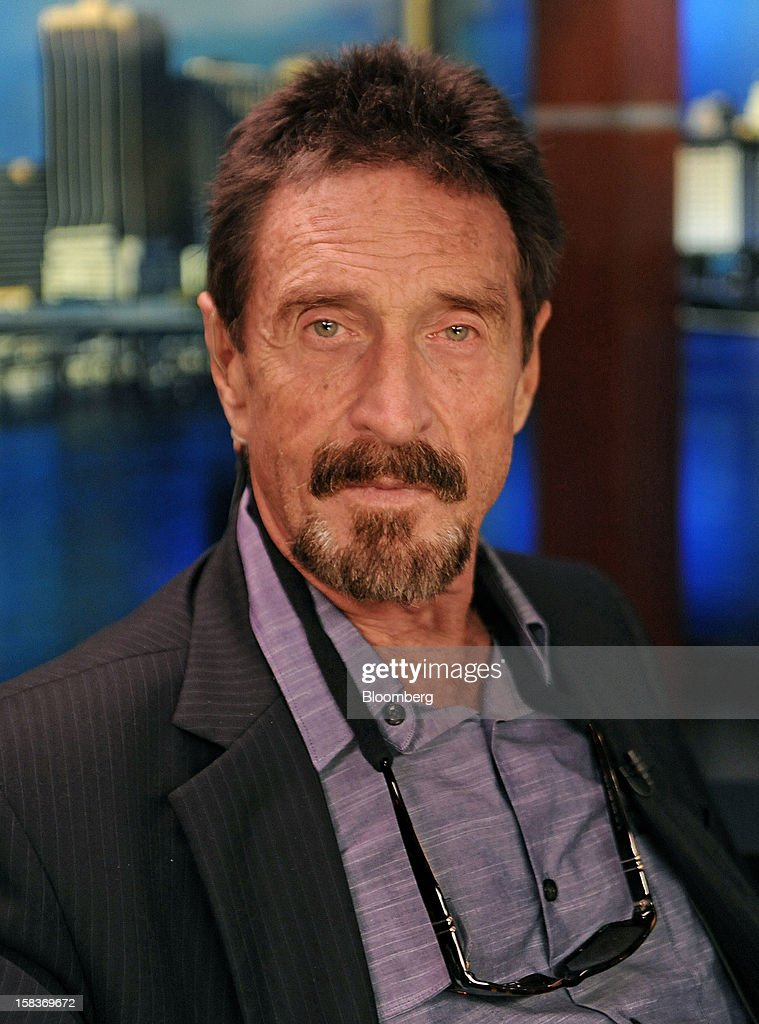 <a gi-track='captionPersonalityLinkClicked' href=/galleries/search?phrase=John+McAfee&family=editorial&specificpeople=1353446 ng-click='$event.stopPropagation()'>John McAfee</a> sits for a photograph following an interview in Miami, Florida, U.S., on Friday, Dec. 14, 2012. McAfee, who is wanted for questioning in the shooting of an American citizen in Belize, was denied asylum by Guatemala. Photographer: Louis Lanzano/Bloomberg via Getty Images