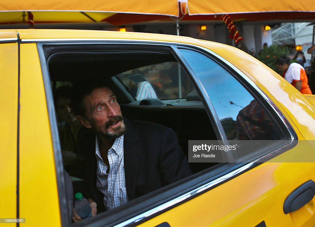 <a gi-track='captionPersonalityLinkClicked' href=/galleries/search?phrase=John+McAfee&family=editorial&specificpeople=1353446 ng-click='$event.stopPropagation()'>John McAfee</a> sits in a cab in front of the Beacon Hotel where he is staying after arriving last night from Guatemala on December 13, 2012 in Miami Beach, Florida. McAfee is a 'person of interest' in the fatal shooting of his neighbor in Belize and turned up in Guatemala after a month on the run in Belize.