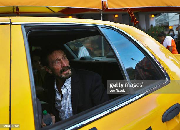 John McAfee sits in a cab in front of the Beacon Hotel where he is staying after arriving last night from Guatemala on December 13 2012 in Miami...