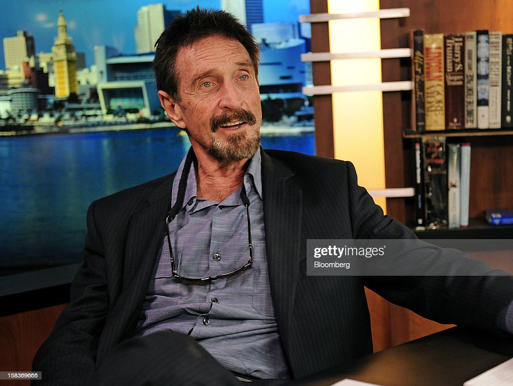 John McAfee speaks during an interview in Miami, Florida, U.S., on Friday, Dec. 14, 2012. McAfee, who is wanted for questioning in the shooting of an American citizen in Belize, was denied asylum by Guatemala. Photographer: Louis Lanzano/Bloomberg via Getty Images