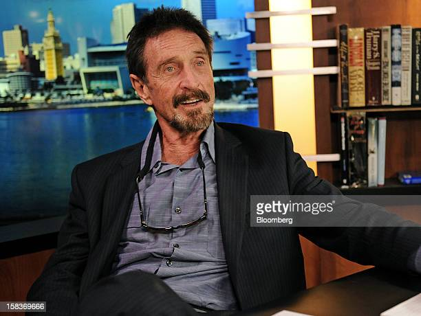 John McAfee speaks during an interview in Miami Florida US on Friday Dec 14 2012 McAfee who is wanted for questioning in the shooting of an American...