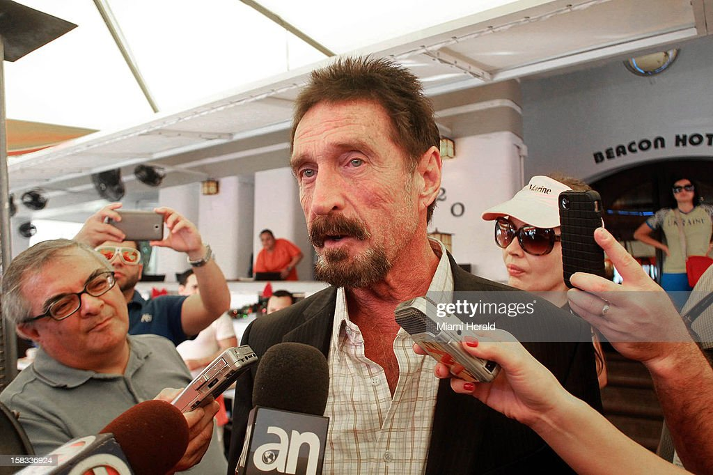 John McAfee speaks to the Miami media outside the Beacon Hotel in Miami, Florida, on December 13, 2012. John McAfee, the controversial guru of computer anti-virus software, denied Thursday in Miami Beach that he's been interviewed by Internal Revenue Service and FBI agents after arriving the previous night following deportation from Guatemala.