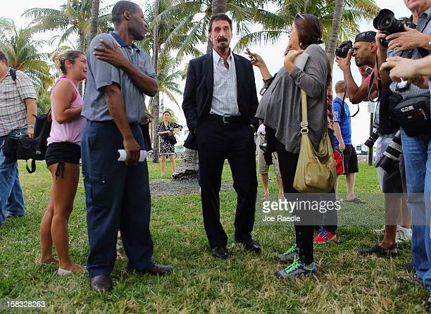 John McAfee speaks with people outside of the Beacon Hotel where he is staying after arriving last night from Guatemala on December 13 2012 in Miami...