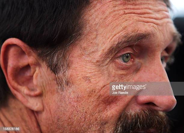 John McAfee speaks with reporters outside of the Beacon Hotel where he is staying after arriving last night from Guatemala on December 13 2012 in...