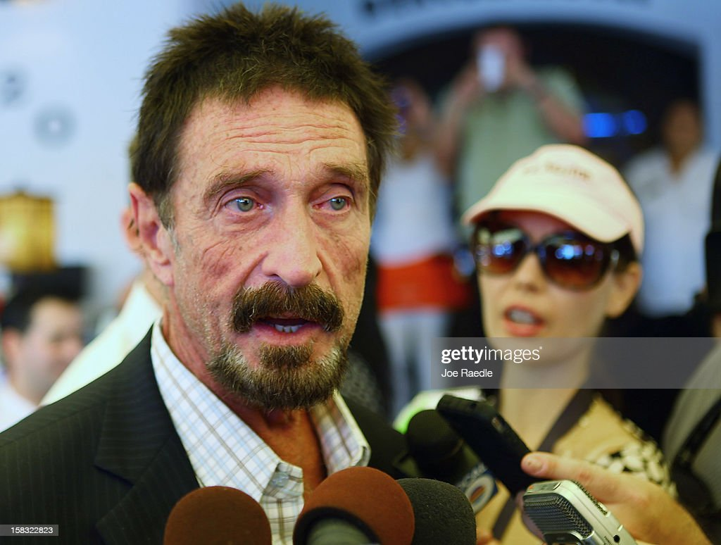 <a gi-track='captionPersonalityLinkClicked' href=/galleries/search?phrase=John+McAfee&family=editorial&specificpeople=1353446 ng-click='$event.stopPropagation()'>John McAfee</a> talks to the media outside Beacon Hotel where he is staying after arriving last night from Guatemala on December 13, 2012 in Miami Beach, Florida. McAfee is a 'person of interest' in the fatal shooting of his neighbor in Belize and turned up in Guatemala after a month on the run in Belize.
