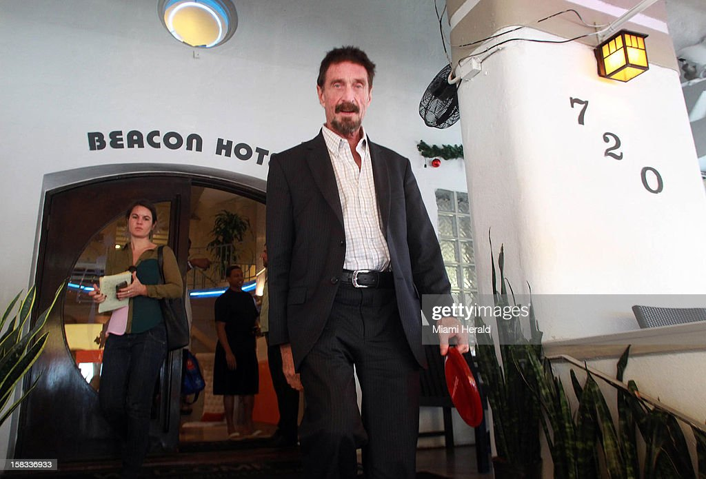 <a gi-track='captionPersonalityLinkClicked' href=/galleries/search?phrase=John+McAfee&family=editorial&specificpeople=1353446 ng-click='$event.stopPropagation()'>John McAfee</a> walks out of the Beacon Hotel in Miami Beach, Florida, on December 13, 2012, after arriving in Miami International Airport from Guatemala on Wednesday, December 12, 2012. <a gi-track='captionPersonalityLinkClicked' href=/galleries/search?phrase=John+McAfee&family=editorial&specificpeople=1353446 ng-click='$event.stopPropagation()'>John McAfee</a>, the controversial guru of computer anti-virus software, denied Thursday in Miami Beach that he's been interviewed by Internal Revenue Service and FBI agents after arriving the previous night following deportation from Guatemala.