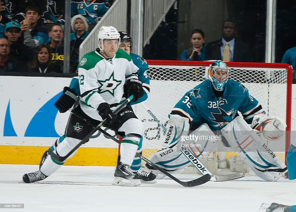 John McCarthy #43 and Alex Stalock #32 of the San Jose Sharks protects the net against Colton Sceviour #22 of the Dallas Stars during an NHL game on December 21, 2013 at SAP Center in San Jose, California.