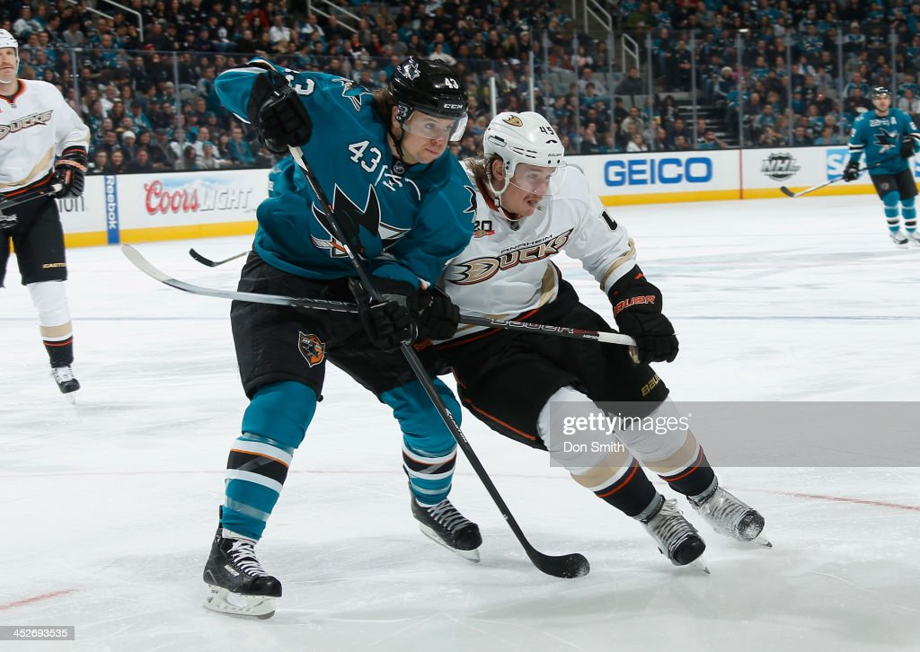 John McCarthy #43 of the San Jose Sharks battles for a pass against <a gi-track='captionPersonalityLinkClicked' href=/galleries/search?phrase=Sami+Vatanen&family=editorial&specificpeople=5894626 ng-click='$event.stopPropagation()'>Sami Vatanen</a> #45 of the Anaheim Ducks during an NHL game on November 30, 2013 at SAP Center in San Jose, California.
