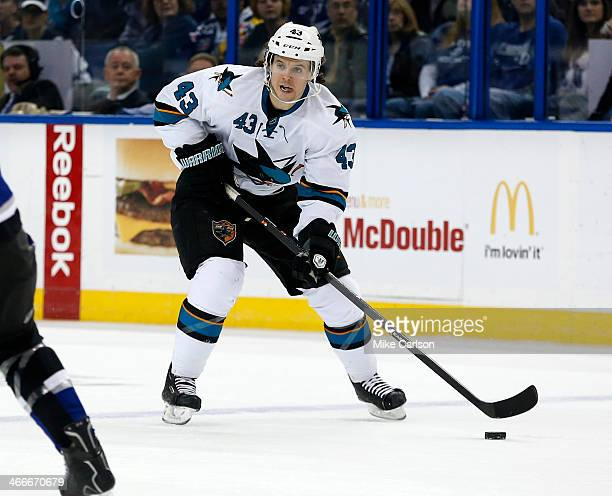 John McCarthy of the San Jose Sharks brings the puck up against the Tampa Bay Lightning at the Tampa Bay Times Forum on January 18 2014 in Tampa...