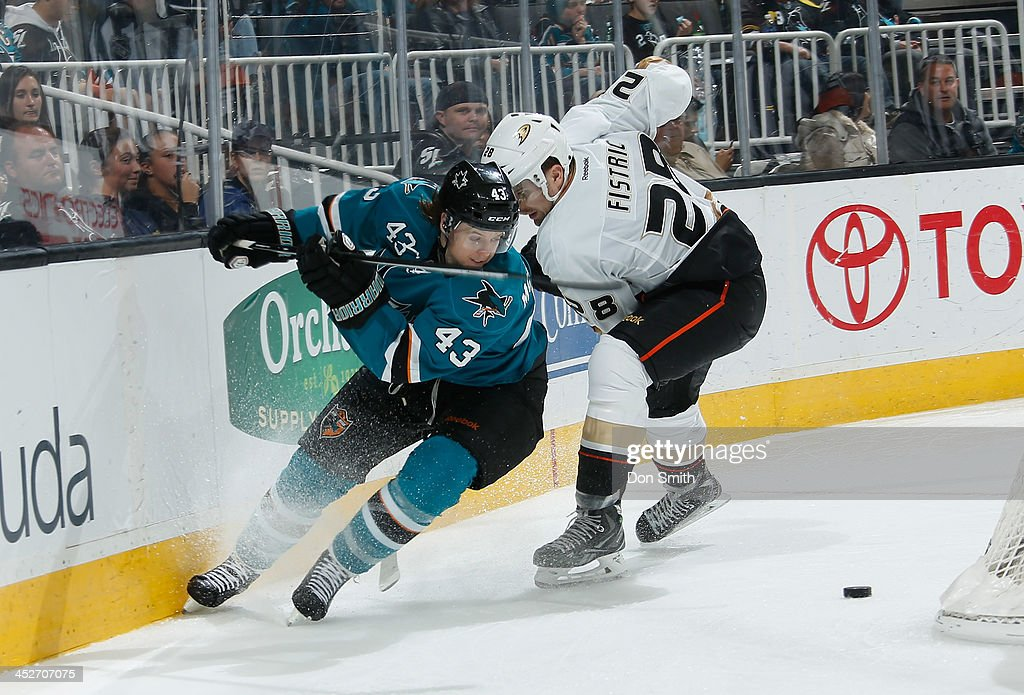 John McCarthy #43 of the San Jose Sharks maneuvers his way up the ice against <a gi-track='captionPersonalityLinkClicked' href=/galleries/search?phrase=Mark+Fistric&family=editorial&specificpeople=2129692 ng-click='$event.stopPropagation()'>Mark Fistric</a> #28 of the Anaheim Ducks during an NHL game on November 30, 2013 at SAP Center in San Jose, California.
