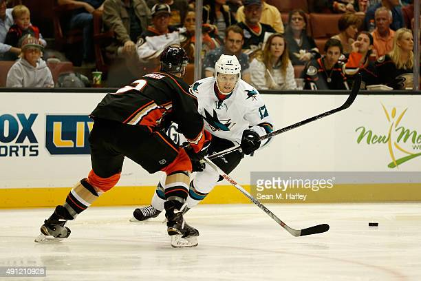 John McCarthy of the San Jose Sharks skates towards Clayton Stoner of the Anaheim Ducks in the second period of a pre season game at Honda Center on...