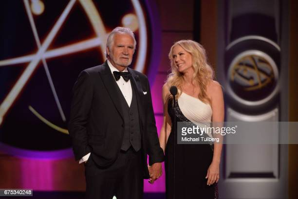 John McCook left and Katherine Kelly Lang speak at the 44th annual Daytime Emmy Awards at Pasadena Civic Auditorium on April 30 2017 in Pasadena...