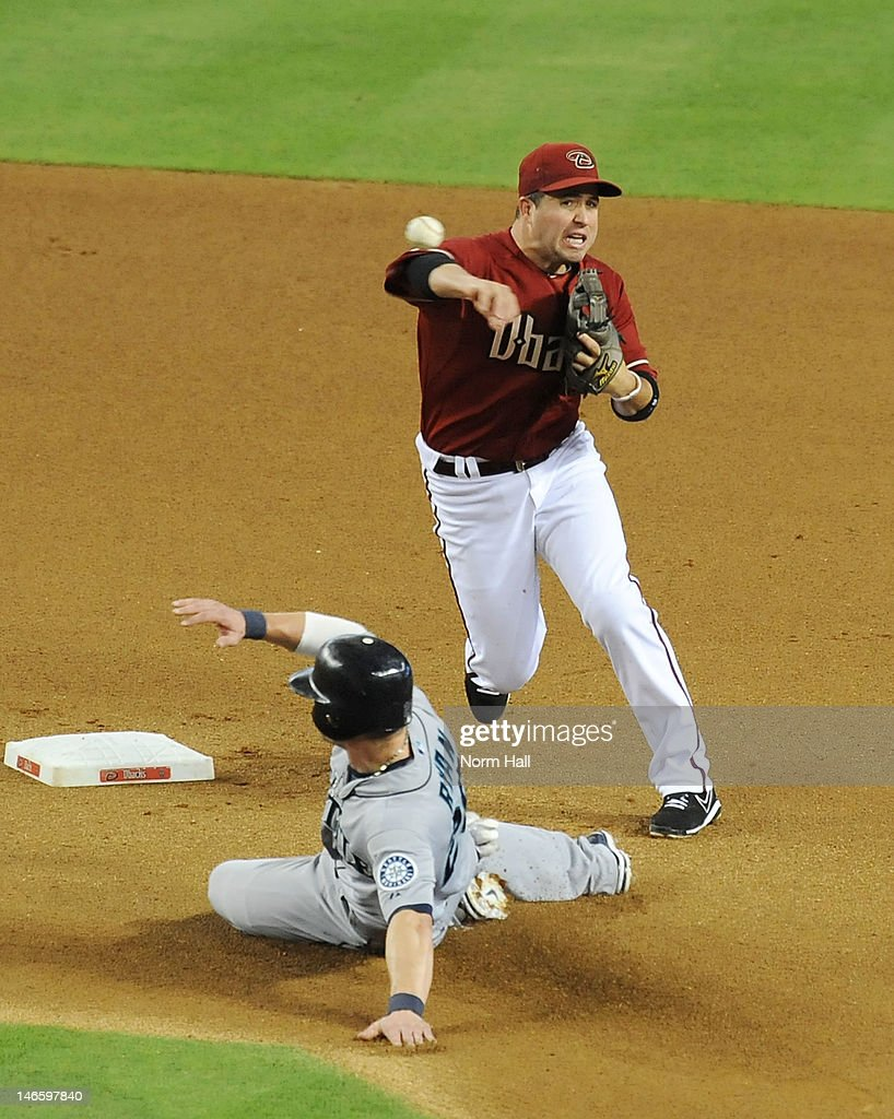 John McDonald #16 of the Arizona Diamondbacks attempts to turn a double play as Brendan Ryan #26 of the Seattle Mariners slides into second base at Chase Field on June 20, 2012 in Phoenix, Arizona.