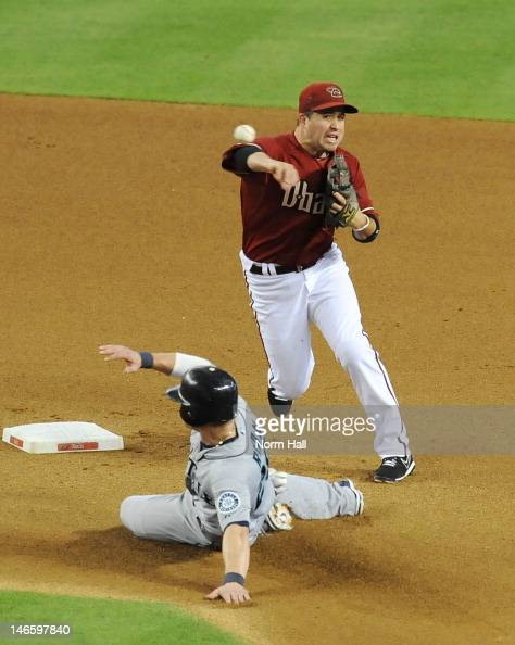 John McDonald of the Arizona Diamondbacks attempts to turn a double play as Brendan Ryan of the Seattle Mariners slides into second base at Chase...