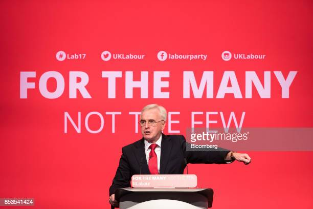 John McDonnell finance spokesman of the UK opposition Labour party gestures during his speech at the Labour Party Annual Conference in Brighton UK on...