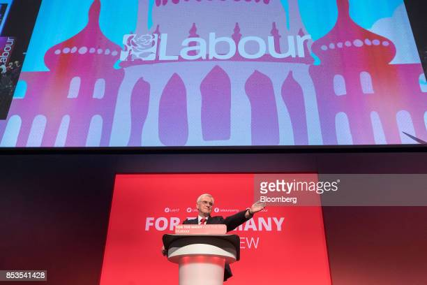 John McDonnell finance spokesman of the UK opposition Labour party gestures as he speaks at the Labour Party Annual Conference in Brighton UK on...
