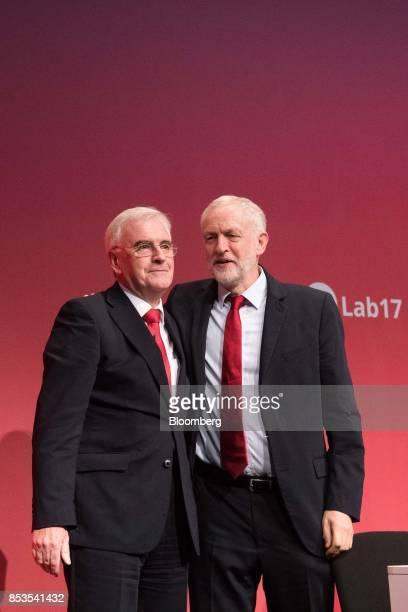 John McDonnell finance spokesman of the UK opposition Labour party left embraces Jeremy Corbyn leader of the UK opposition Labour Party right at the...