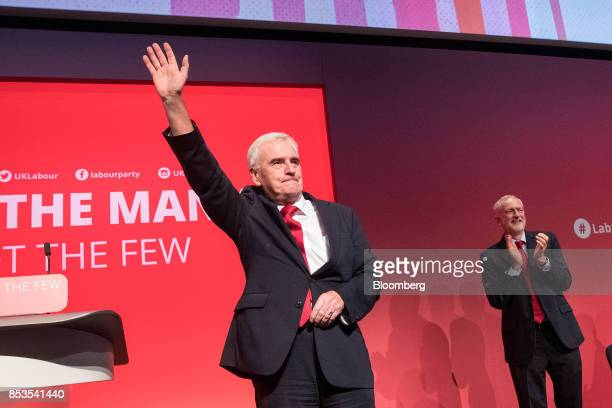 John McDonnell finance spokesman of the UK opposition Labour party waves at the end of his speech as Jeremy Corbyn leader of the UK opposition Labour...