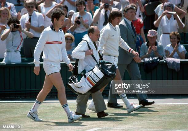 John McEnroe and Jimmy Connors of the USA prior to the men's singles final at the Wimbledon Lawn Tennis Championships in London on 8th July 1984...