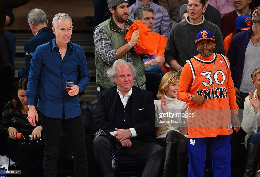 John McEnroe (L) and Spike Lee (R) attend the Chicago Bulls vs New York Knicks game at Madison Square Garden on January 11, 2013 in New York City.