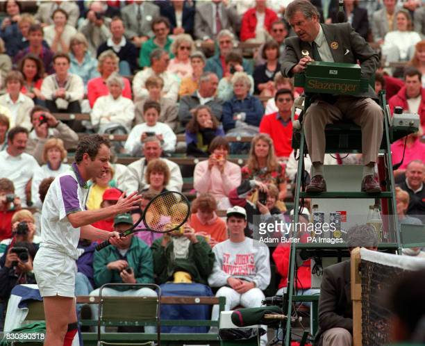 John McEnroe argues a linecall with umpire George Grime during his quarterfinal against Guy Forget on Court One at Wimbledon
