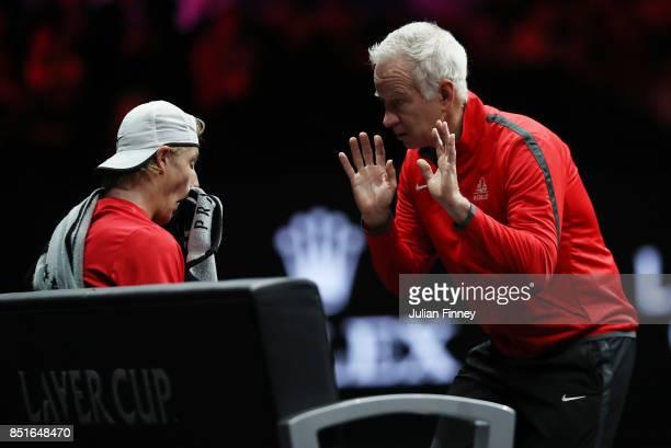 John Mcenroe Captain of Team World and Denis Shapovalov of Team World talk on the bench during his singles match against Alexander Zverev of Team...