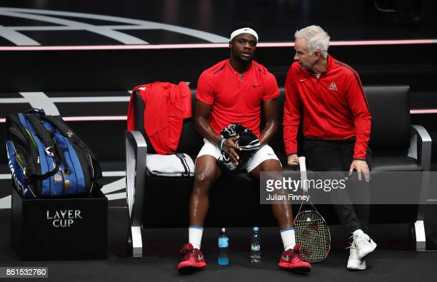 John Mcenroe Captain of Team World and Frances Tiafoe of Team World looks on from the bench as he plays Marin Cilic of Team Europe in his singles...