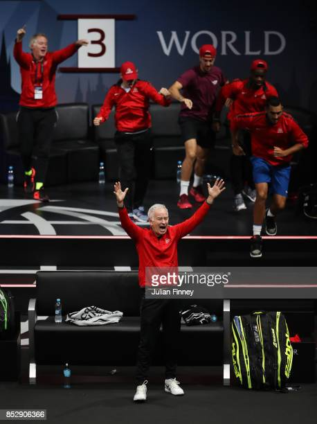 John Mcenroe Captain of Team World celebrates as Jack Sock playing with John Isner of Team World celebrates winning match point during there mens...