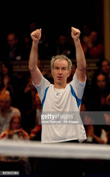 John McEnroe celebrates after defeating Anders Jarryd during the Blackrock Masters at the Royal Albert Hall London