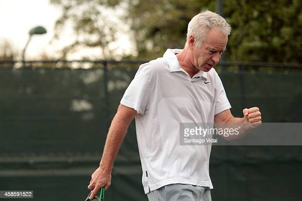 John McEnroe celebrates after scoring a point during an exhibition match between John McEnroe and Jim Courier at Casa de Campo Hotel on November 07...