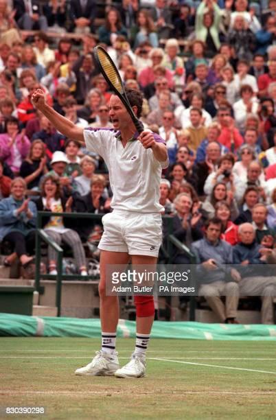 John McEnroe celebrates his threeset victory over Guy Forget