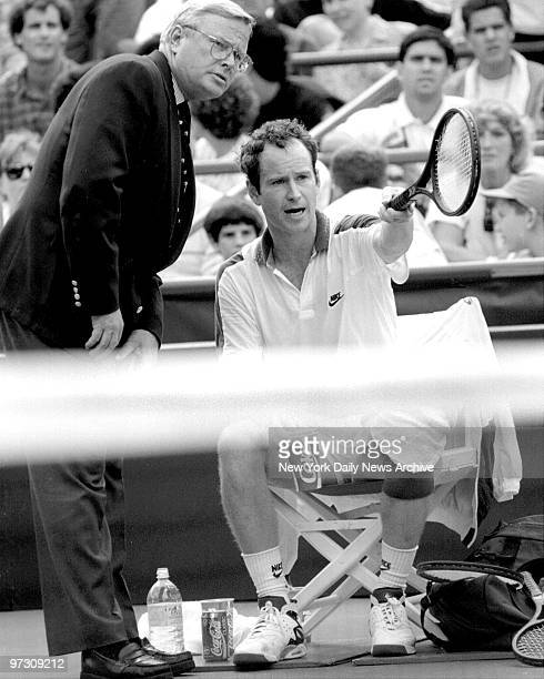 John McEnroe confers with referee about a disturbance