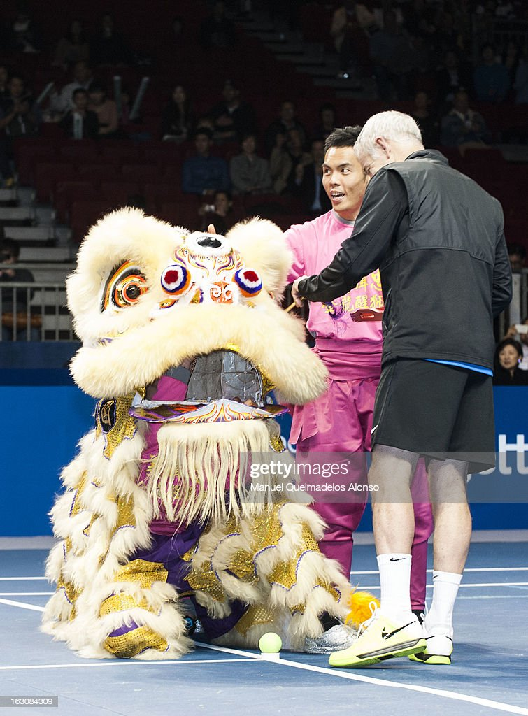 John McEnroe dots into the eye of a Chinese Dancing Lion priot his match against Ivan Lendl as part of the Hong Kong Showdown at the Asia-World Expo on March 4, 2013 in Hong Kong, China.