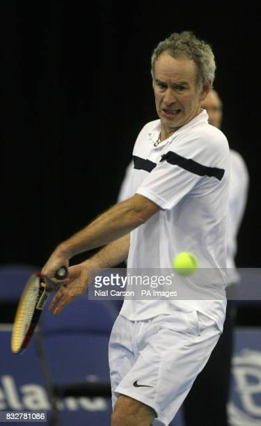 John McEnroe in action against Jeremy Bates during the Tennis Legends tour at Belfasts Odyssey Arena