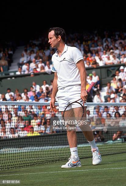 John McEnroe in action during a men's singles match at the Wimbledon Lawn Tennis Championships circa 1993 at the All England Lawn Tennis and Croquet...