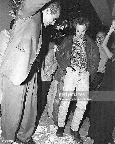 John McEnroe is encouraged by Casa La Femme Restaurant owner Anastasi Hairatidis to dance on plates he broke on the floor Guests at the trendy SoHo...