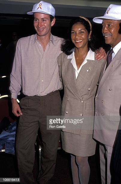 John McEnroe Jeanne Ashe and David Dinkins during Benefit for the Arthur Ashe AIDS Tennis Challenge at The Grand Hyatt Hotel in New York City New...