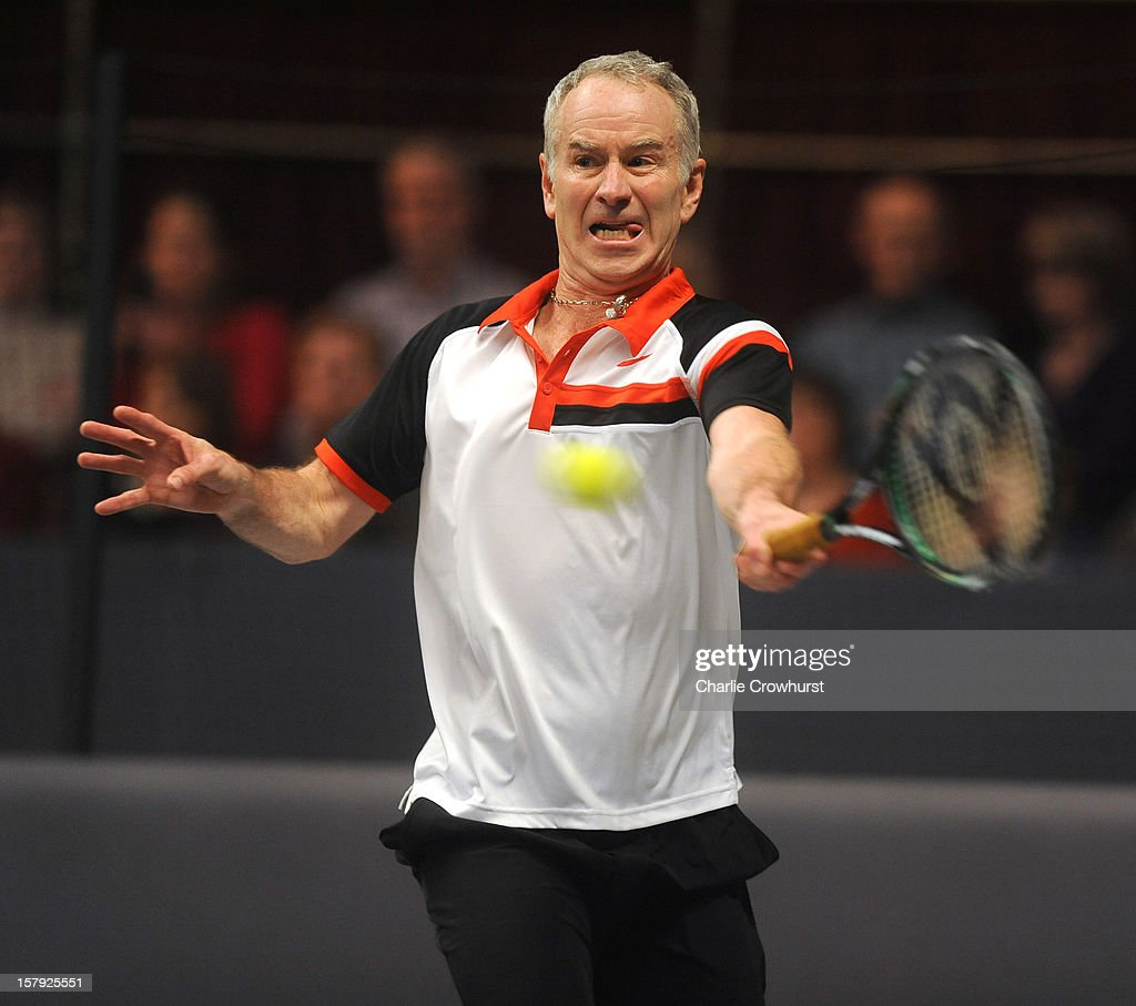 <a gi-track='captionPersonalityLinkClicked' href=/galleries/search?phrase=John+McEnroe&family=editorial&specificpeople=159411 ng-click='$event.stopPropagation()'>John McEnroe</a> of America hits a forehand during the match against Guy Forget of France on Day Three of the Statoil Masters Tennis at the Royal Albert Hall on December 7, 2012 in London, England.