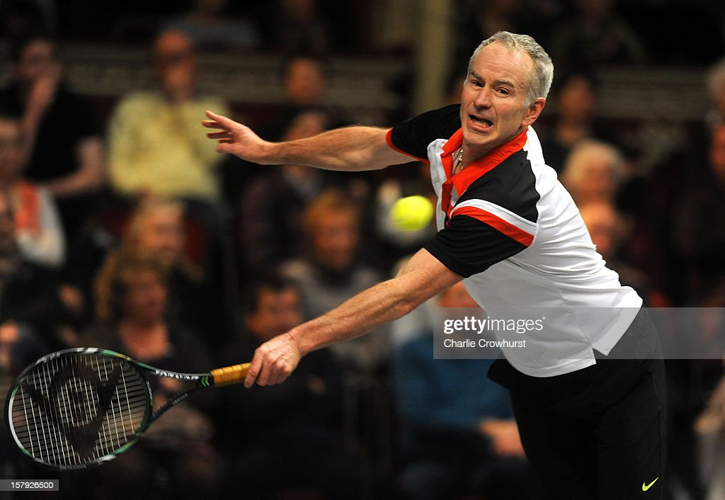 John McEnroe of America stretches for a backhand during the match against Guy Forget of France on Day Three of the Statoil Masters Tennis at the Royal Albert Hall on December 7, 2012 in London, England.