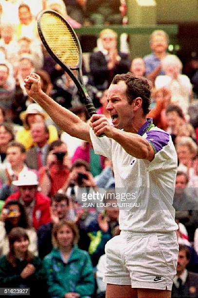 John McEnroe of the United States celebrates as he wins his quarterfinal match against France's Guy Forget in three sets 62 76 63 at the Wimbledon...