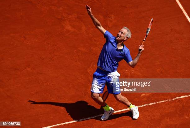 John McEnroe of The United States partner of Cedric Pioline of France in action during Mens Legends match against Pat Cash of Australia and Michael...