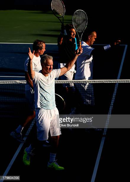 John McEnroe of the United States Patrick McEnroe of the United States Cedric Pioline of France and Mats Wilander of Sweden wave to the crowd after...