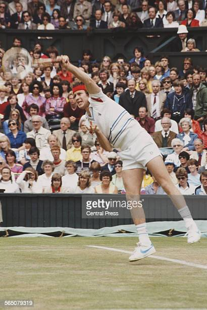 John McEnroe of the United States serves to Bjorn Borg during the Men's Singles Final match at the Wimbledon Lawn Tennis Championship on 4 July 1981...