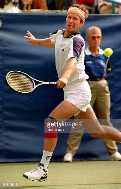 John McEnroe of the US returns the ball to Australia's Richard Fromberg 05 September 1992 at the US Open McEnroe is seeded 16th in the tournament